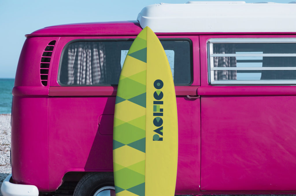 surfboard placed on a red and white classic van on the beach useful as a surf background - focus on the board